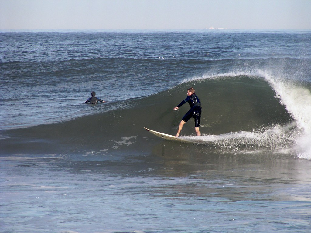 two people surfing