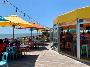 Beach Club mentioned in Full Passport's Best 25 Restaurants in Rehoboth Beach Article